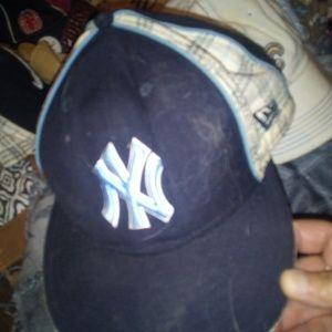 Man's NY baseball cap